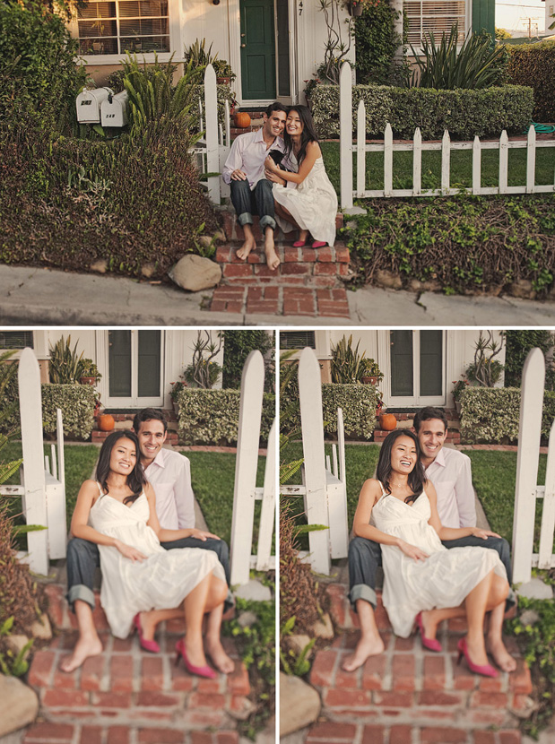 couple in front of white picket fence
