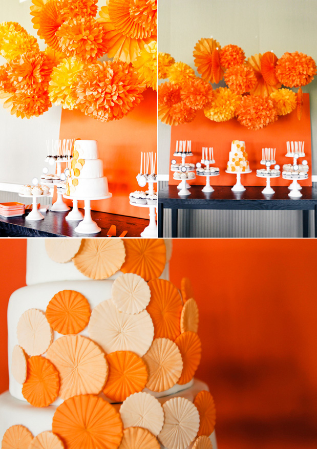 bright orange wedding cake display buffet tissue paper pom poms