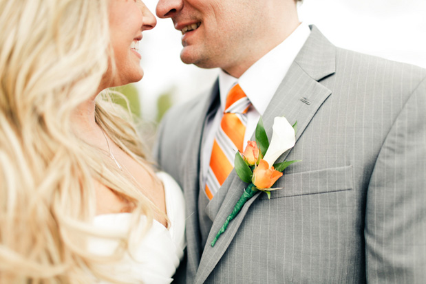 orange and white striped tie boutonniere