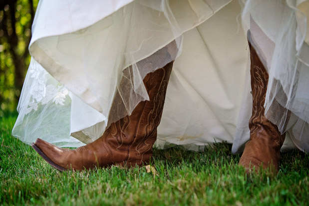bride cowboy boots rustic fall wedding on a farm